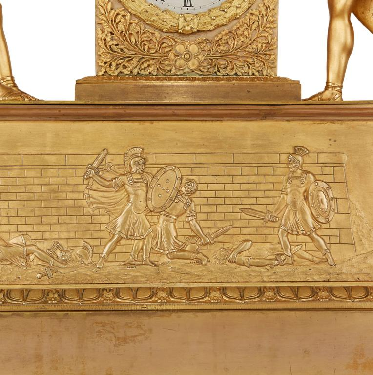 Gilt Empire Style Ormolu Clock Set Depicting the Oath of the Horatii For Sale