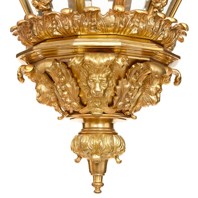 This exquisite lantern takes an octagonal beehive shape, which is often referred to as 'Versailles' shape, as it was based on an 18th Century model built for the Chateau of Versailles. The frame of the lantern is formed in ormolu, and the upper