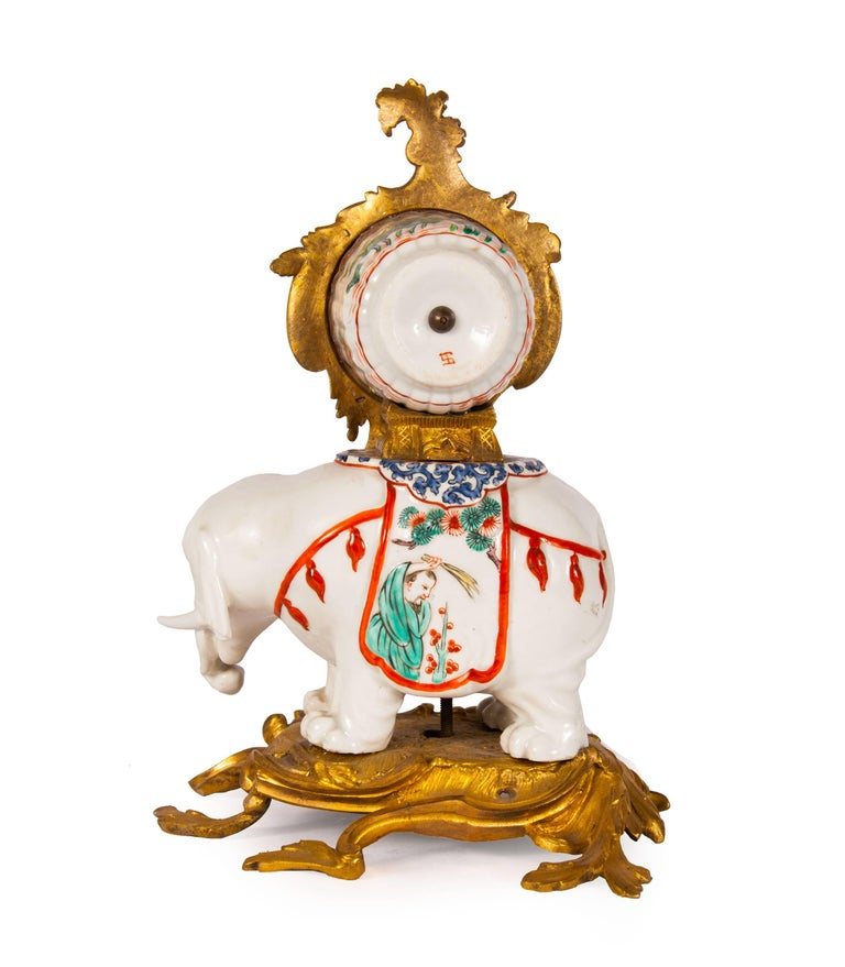 This exquisite and delicate clock typifies the European fascination in the 19th century with Chinese art and orientalist themes. The circular clock dial is bordered with asymmetric ormolu, styled as acanthus leaves and features a white dial and