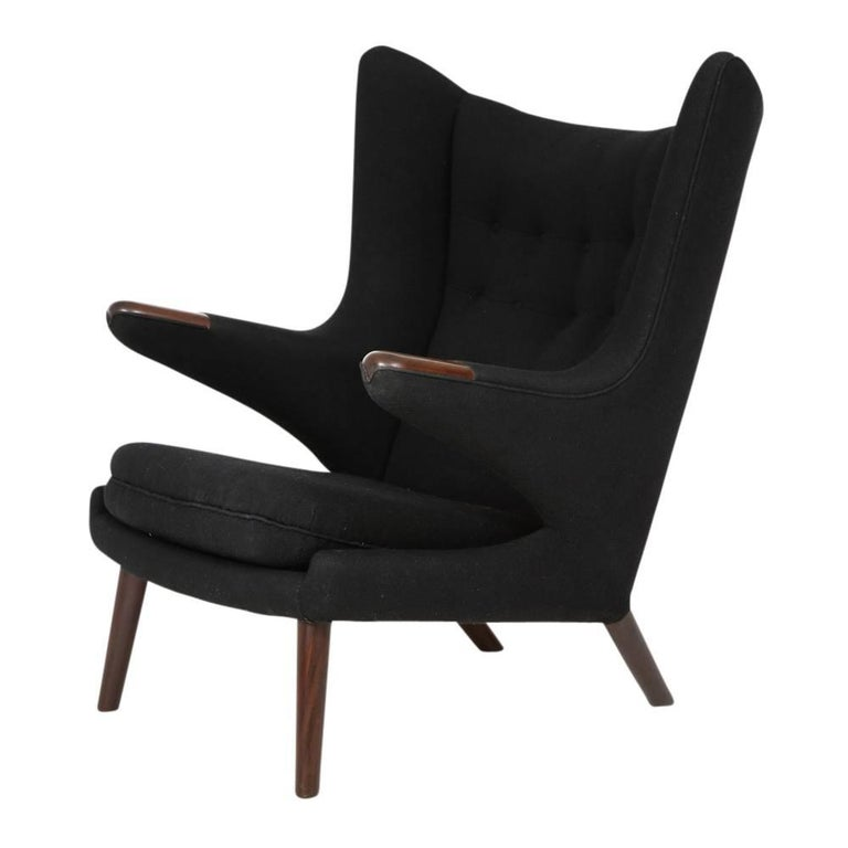 Hans Wegner Papa Bear chair and ottoman teak A.P. Stolen signed, Denmark 1960s. Purchased directly from the original owner via an auction. Covered in the original black wool fabric and even retains two black replacement upholstery buttons sewn into