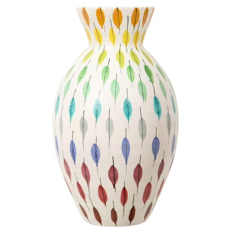 Bitossi Raymor ceramic vase Piume multi color feather signed, Italy, 1960s. Aldo Londi's iconic feather pattern motif: Piume multicolored. Tapered neck widens at the body. Signed J 050054, Italy on the underside of the vase. Londi was Bitoss's