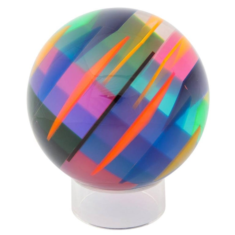 Vasa Mihich sphere, laminated cast acrylic, blue, magenta, orange, signed. Large tabletop sculpture by vase composed of laminated cast acrylic sphere with an array of internal wedge shape colors. The colors change depending on the light. Signed