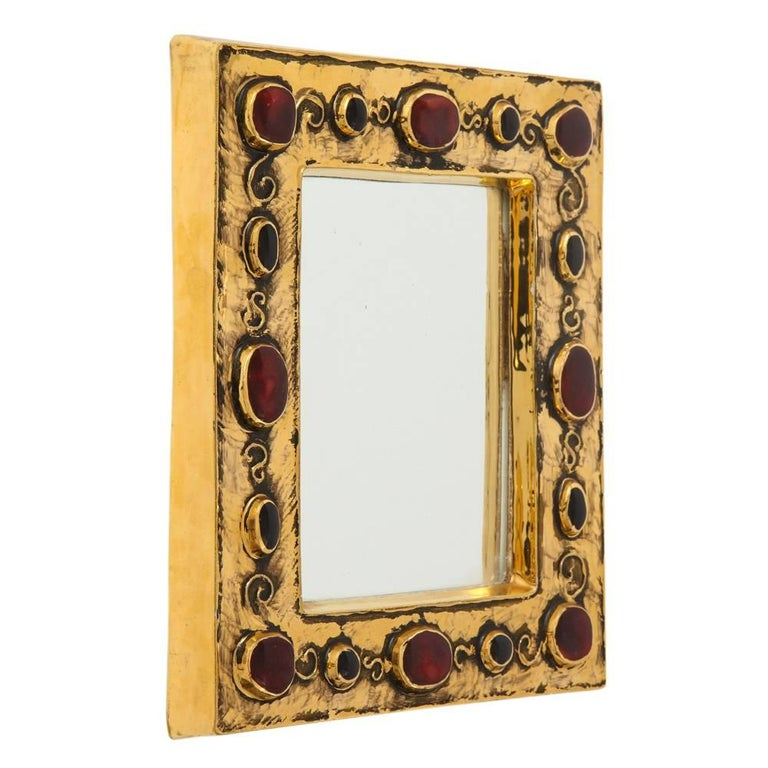 Francois Lembo ceramic mirror gold red jewel signed, France, 1970s. Signed F. Lembo on the back.  A native of Vallauris François Lembo started his pottery career in 1951 in the workshops of Calva and Rossignol. After his apprenticeship and having