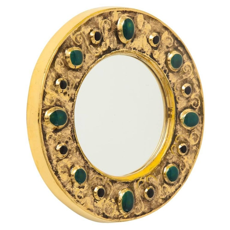 Francois Lembo mirror, ceramic, jeweled, gold, emerald green, signed. Small scale gold glazed mirror with embedded jewel decoration. Signed F. Lembo with incised signature on the back.   A native of Vallauris François Lembo started his pottery