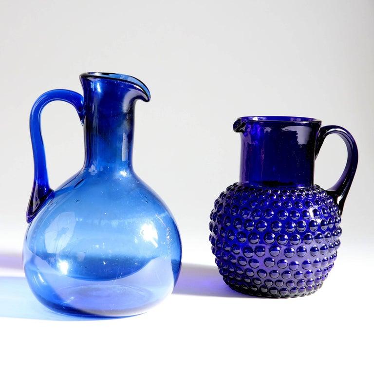 A late 19th century Bristol blue glass bulbous jug.