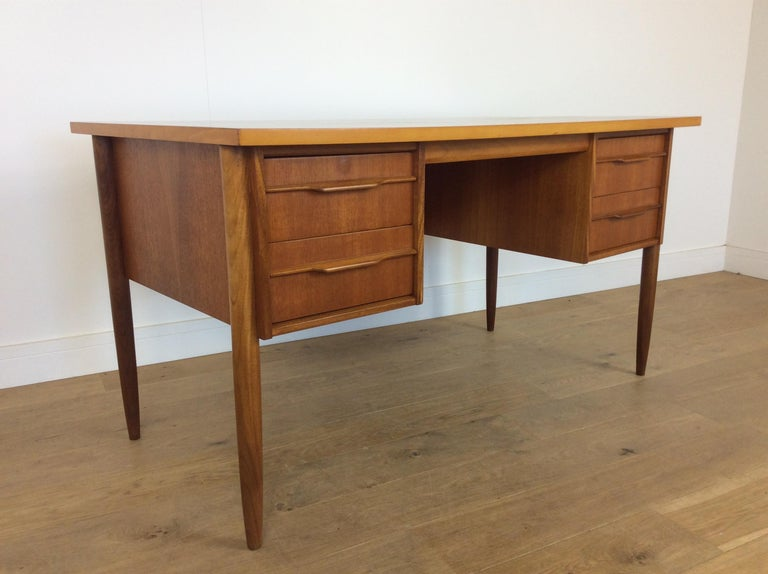 Midcentury desk. Midcentury teak desk with twin drawers either side of the kneehole. 74 cm h 137 cm w76 cm d Danish, Circa 1960