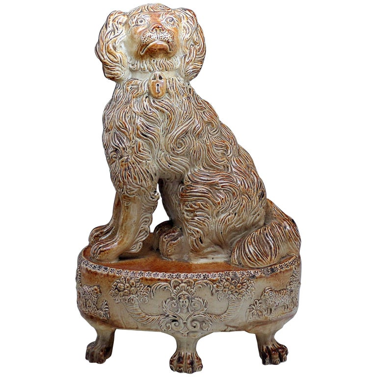 Antique Salt Glaze Pottery Spaniel Seated on Oval Base, circa 1835 Derbyshire UK