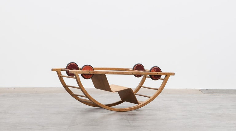 Swing cart, children toy in lacquered red wood and metal, Germany, 1951.  Authentic swing cart from the 1950s. Unique in shape and workmanship designed by Hans Brockhage. A German designer and sculptor from East Germany. The swing cart can be used