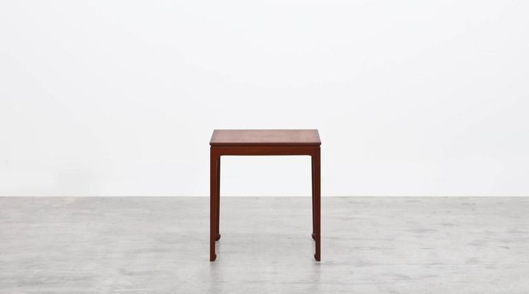 This elegant pair of side tables designed by Ole Wanscher are in mahogany. The proportions are fine and delicate and comes on nicely modeled spade feet. Papers label on underside. Manufactured by A. J. Iversen.