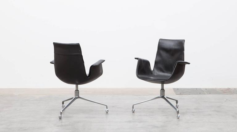 Black leather, chromium-plated, Swivel Chair by Fabricius and Kastholm, Germany, 1960.  Beautiful black leather swivel armchairs on chromium-plated metal base in great condition. Designed by Preben Fabricius and Jørgen Kastholm. Manufactured by Kill