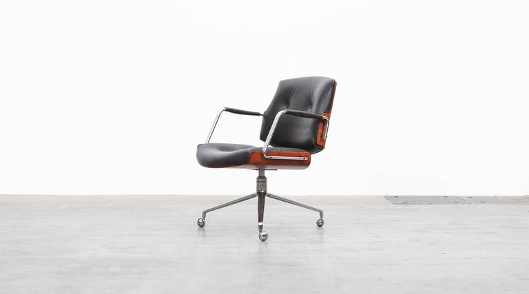 Black leather, Rosewood, Swivel Chair by Fabricius and Kastholm, Germany, 1968.  Classical swivel chairs designed by Preben Fabricius and Jørgen Kastholm. The chair has a brushed steel tripod foot, high quality leather upholstery and two curved