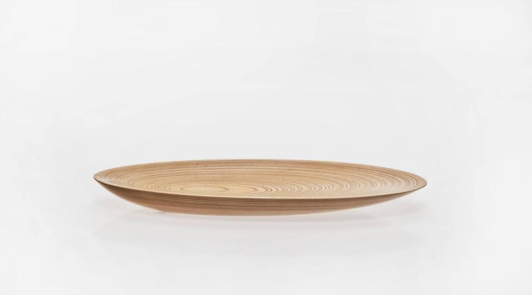 Rare leaf dish designed by Tapio Wirkkala. A leading figure of Post-war European design, Finnish designer and sculptor. The wood rings in two colors on Tapio Wirkkala's laminated plywood dishes emphasize its shell-like shape, combining the at-once
