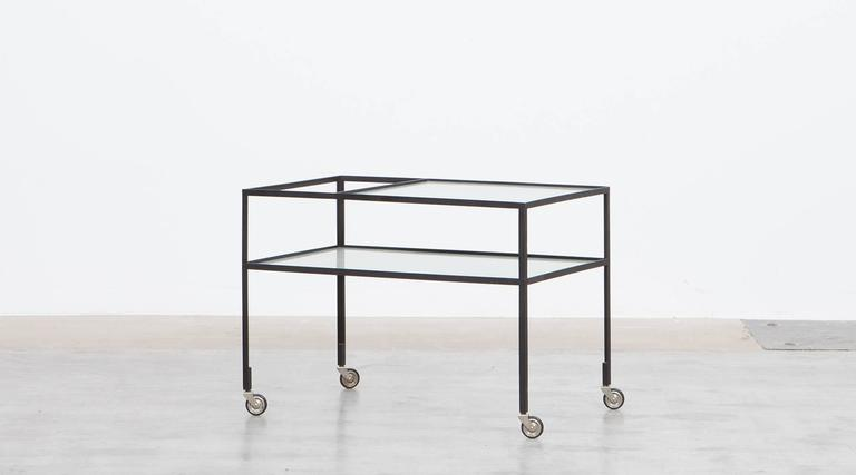 Slender Serving Cart in steel with original reeded glass plates is designed by German architect Herbert Hirche. The slender and reduced steel frame holds the very well-preserved original glass plate. Manufactured by Christian Holzäpfel KG.   Bauhaus