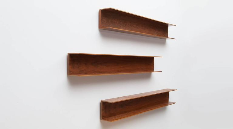 Set of three wall shelves designed by Walter Wirtz in wood. U-shaped structure in minimalistic German design from the early 1960s. The shelves are reworked and comes in very good condition. Manufactured by Wilhelm Renz.