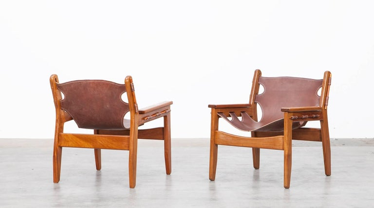 Beautiful Brazilian solid Imbuia wooden and leather Kilin lounge chairs designed by Sergio Rodrigues in 1973. The original and nicely aged leather sling seat has a great patina and looks beautiful in contrast with the warm Imbuia wooden frame. The