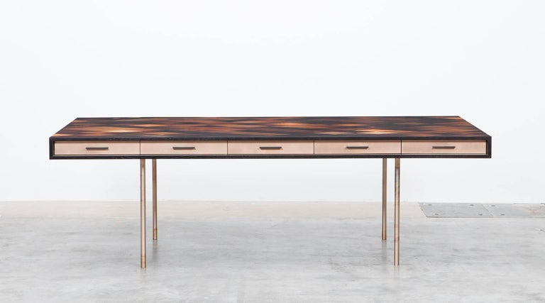 Desk by contemporary artist Johannes Hock, veneered tabletop in diamond pattern with thirty different types of wood. Five front drawers in bronze. Hidden access to electricity under the pattern which can be adjusted to personal taste. Similar