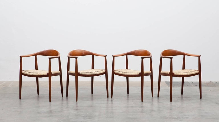 Classic teak chairs with woven cane seat or simply