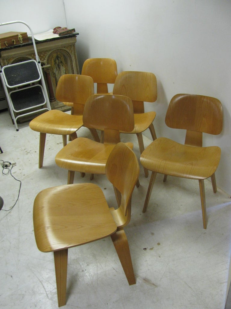 Iconic DCW Eames dining chairs in oak plywood. Chairs have been in storage for over 30 years so there is very little wear to them. Herman Miller metal tags on four of the six. Chairs are from the 1970s.