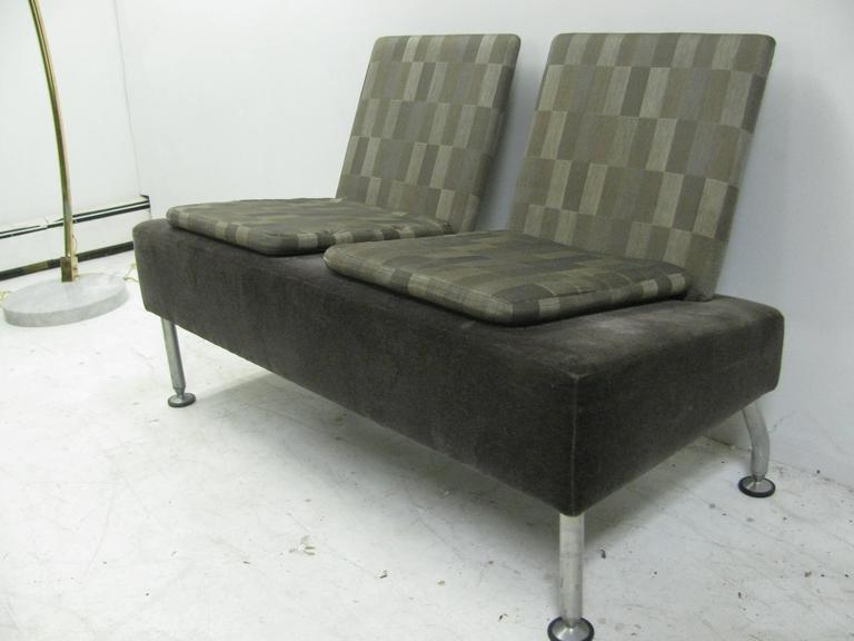 Sleek, simple and well constructed. Base is covered in gray cotton velvet. Seat backs and cushion pads in a gray checker board. Stainless steel legs.