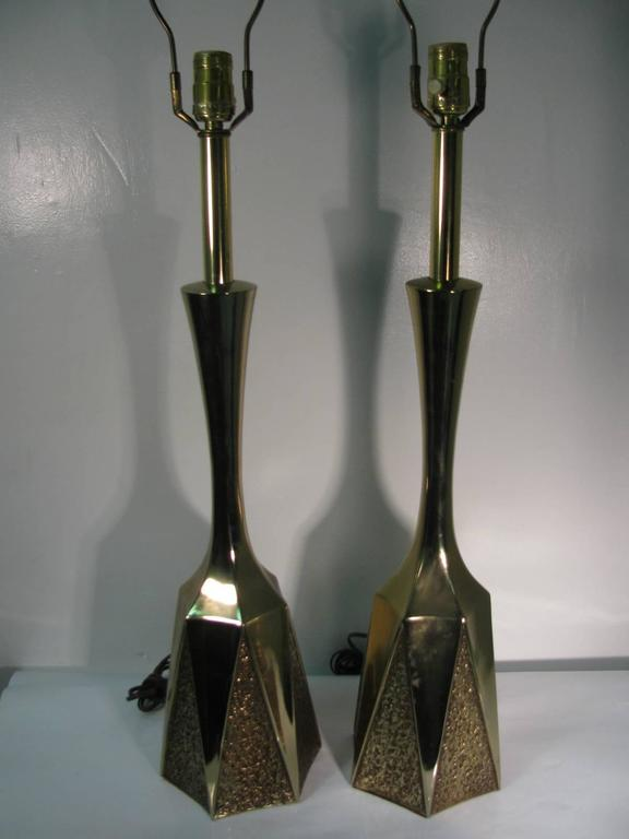 Pair of brass table lamps with a diagonal lava base. In excellent working condition with new sockets. Measurements are to top of the socket. New sockets.
