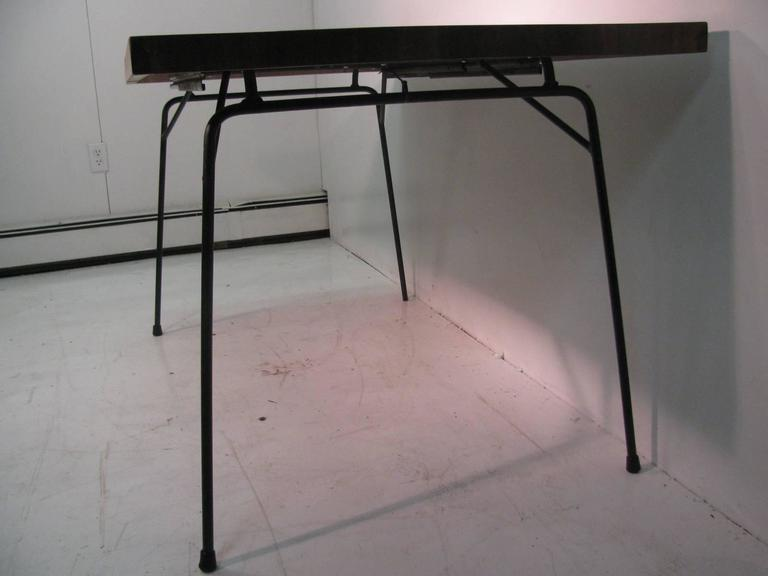 American Mid-Century Modern Black Walnut and Iron Dining Table by Clifford Pascoe For Sale