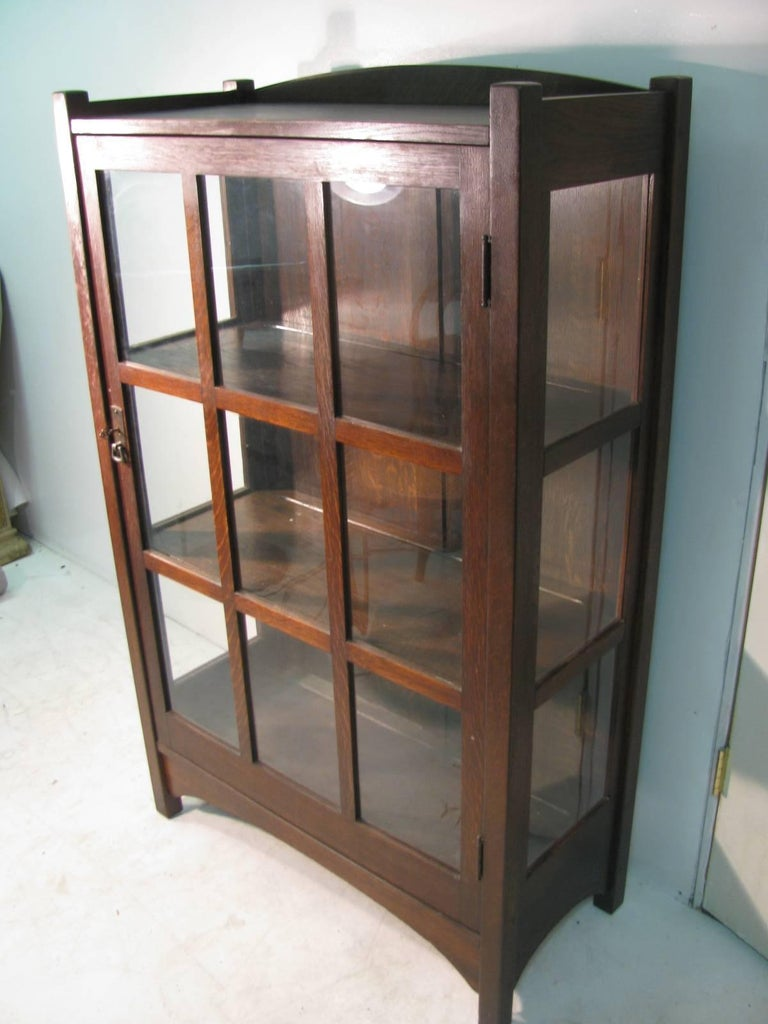 Beautiful handcrafted China, closet by the Stickley Bros., Leopold and John George. Great size with three fixed shelves. Divided panes of glass are all original along with finish of the quarter sawn oak. Cabinet is unsigned but guaranteed to be