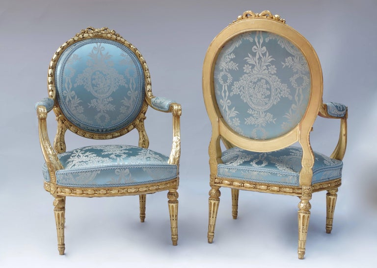 French Pair of Louis XVI Style Giltwood Armchairs, Medallion Shape Backrest, circa 1880
