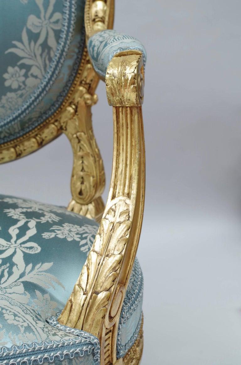 Late 19th Century Pair of Louis XVI Style Giltwood Armchairs, Medallion Shape Backrest, circa 1880