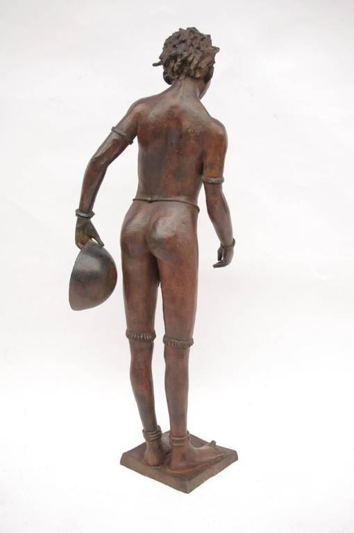 """Signed Jacques Darbaud and numbered 6/8. Patinated bronze. French work. """"Young Congolese with gourd."""""""