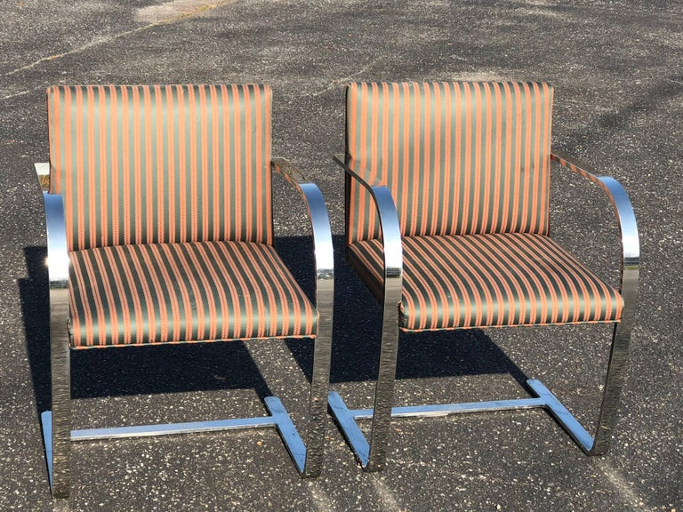 Pair of Flat Bar Brno Chairs attributed to Ludwig Mies van der Rohe for Knoll. In a nice pinstripe fabric. Can be recovered. Perfect for dining or office. Heavy, solid pieces.