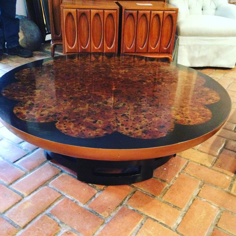 Muller and Barringer for Kittinger 'Lotus' coffee table. This iconic mandarin style table will be the focal point of any Hollywood Regency style decor. Faux tortoiseshell floral medallion top is rich and textual in design. Similar in style to James