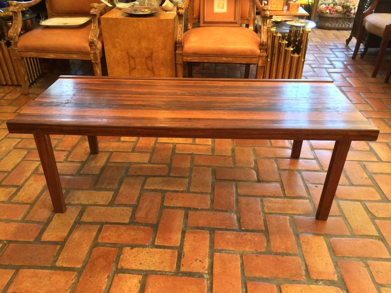 Signed A.H. McIntosh Mid-Century rosewood coffee table.  Classic parsons shape with simple minimalist lines. Beautiful rosewood grain makes up this classic table. Perfect size for most sofas. Rare,exotic wood  that is now considered extinct. Buy a