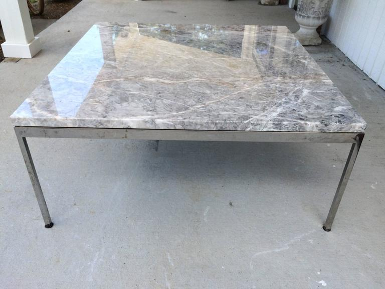 Sleek chrome and marble coffee table. This elegant table will go with any style decor from Minimalist to Hollywood glamour to Mid-Century Modern. Timeless. No pitting to chrome. Just reflections on ground.