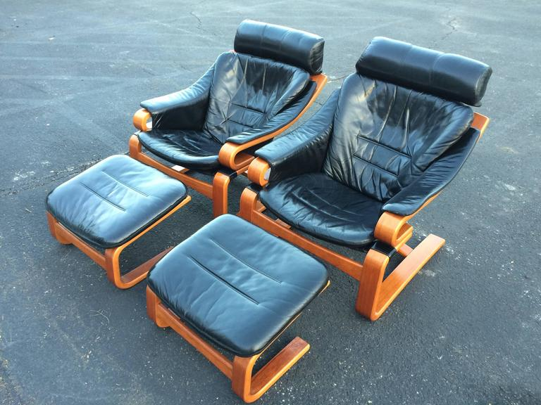 Pair of Danish modern leather lounge chairs with ottomans by Skipper Mobler. Model name
