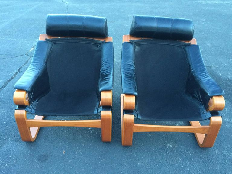 Pair of Danish Modern Leather Lounge Chairs with Ottomans For Sale 3