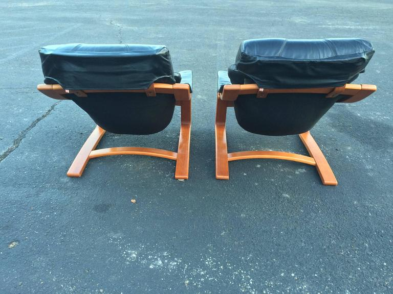 Pair of Danish Modern Leather Lounge Chairs with Ottomans 10
