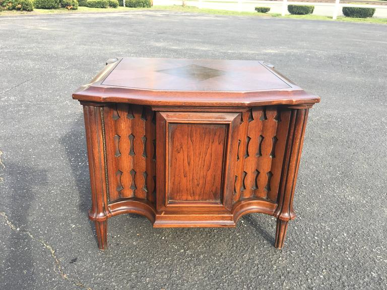 Mid-Century Brutalist cabinet or end table. Sculpted wooden door front opens to great storage. Geometric veneer design on cabinet top. Great as a nightstand or end table. Great design piece for high gloss lacquering as well.