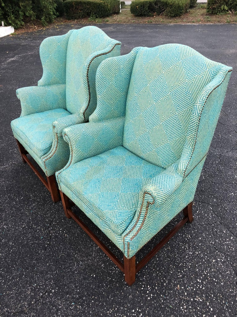 Pair of Henredon Wing Back Chairs in Turquoise. Fabulous fabric, just worn at arm rest ends. All brass tacks have been replaced. Strong and structurally sound.