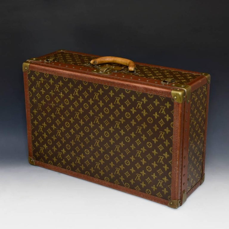 d6c9a1aef347 Louis Vuitton suitcase in LV monogram pattern with lozine trim and brass  corners