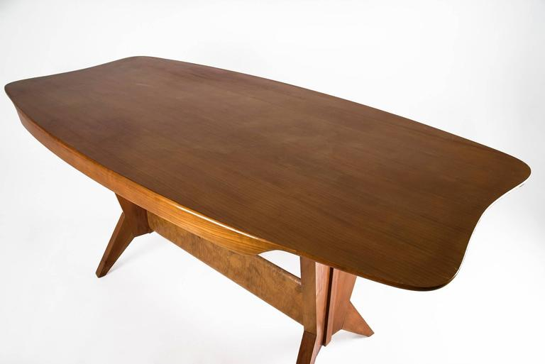 Dining table characterized by an impressive design, manufactured in Italy in the 1940s. Wooden structure with a central briar-root beam. Good original vintage conditions.