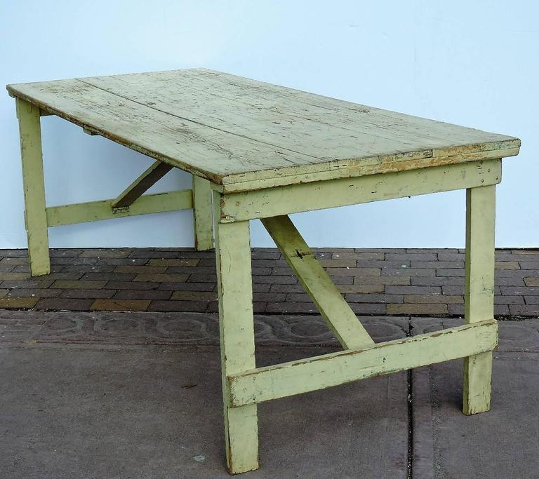 American Collapsible Leg Rustic Farm Table In Old Pale Yellow Paint For Sale