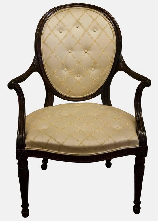 Reupholstered mahogany Hepplewhite elbow chair.