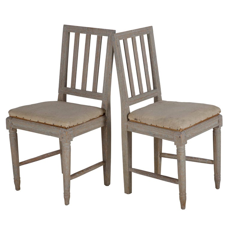 Set of four Gustavian Provincial dining chairs in original paint.