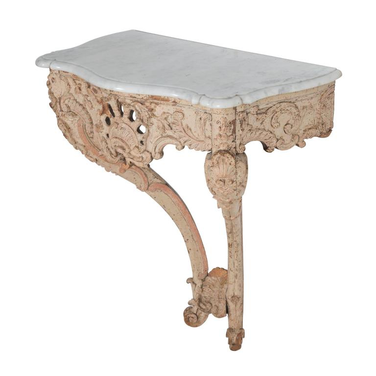 Decorated console table with marble top.