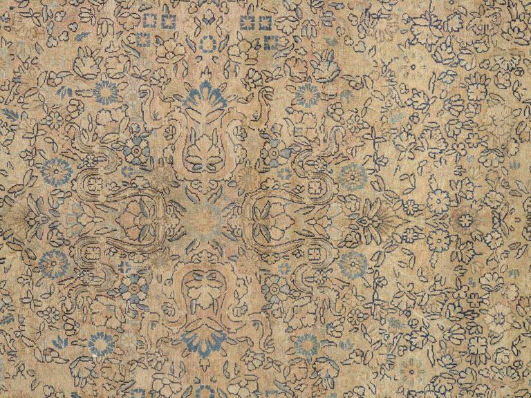 This master crafted Persian Laver Kerman carpet exemplifies the profound understanding of the artistic principles of balance and harmony that make art-level antique rugs so inspiring to live with. Indicative of the best classical Persian carpets of