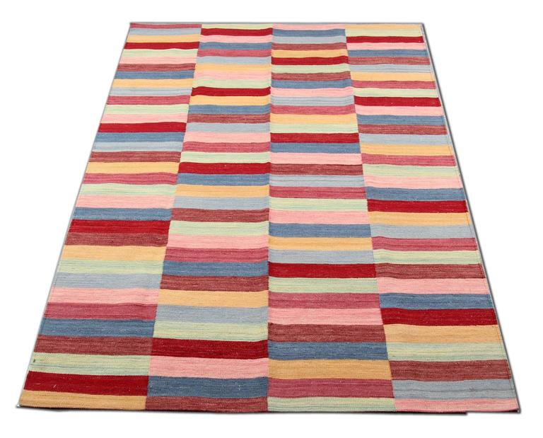 This Kilims with stripes is handmade rugs in Afghanistan with natural materials: Only the best wool and cotton and organic dyes have been used. This modern rugs design reproduces multicolored stripes. flat weave rug is hardwearing and for this