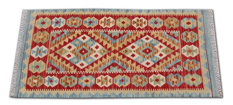 This colorful carpet rug is woven by very skilled weavers in Afghanistan, who used the highest quality wool and cotton. The flat weave rug has blue, orange, green, white, pink and red colors. The white background of this geometric rug has the same