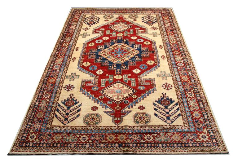 This traditional handwoven tribal rug with bold colors of cream, light blue and red featuring intricate geometric rug designs of stars, peacocks trees encompassing three medallions. This cream rug is handmade with wool and cotton. Afghan rugs would