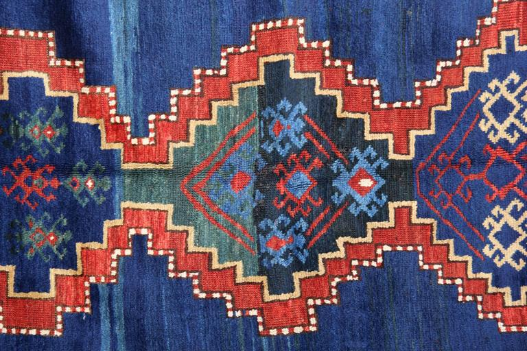 Kazak rugs have primarily produced as village productions rather than city pieces. Made from materials particular to individual tribal provinces and the rugs of the Caucasus typically display bold geometric designs in primary colors. Kazak rugs are