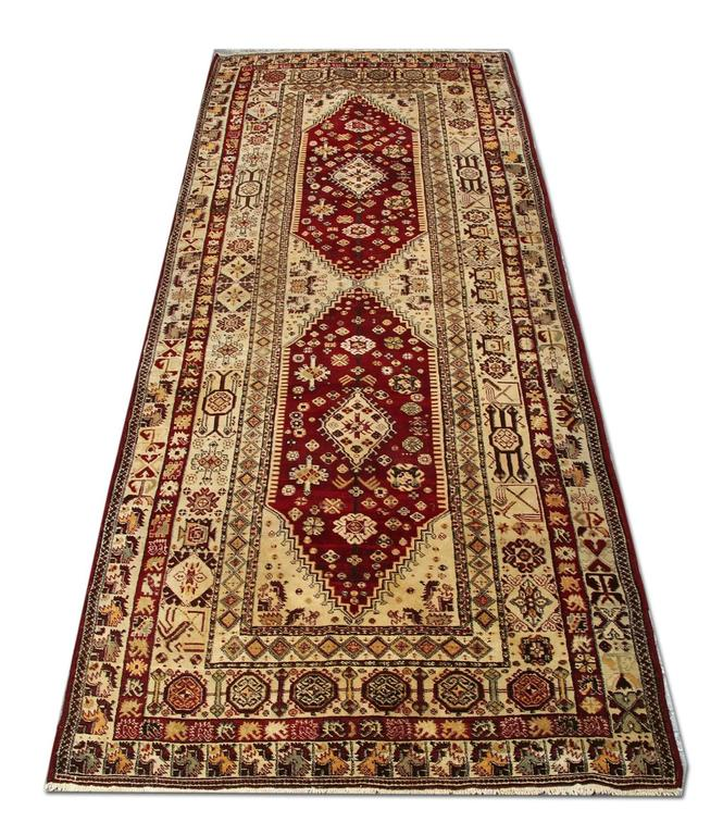 This is an Indian Agra floral rug in a very good condition. The rust colour on this woven rug has sat in harmony with the lime green and the gold color of the carpet. The segmented border of this carpet rug gives it the subtle look. These